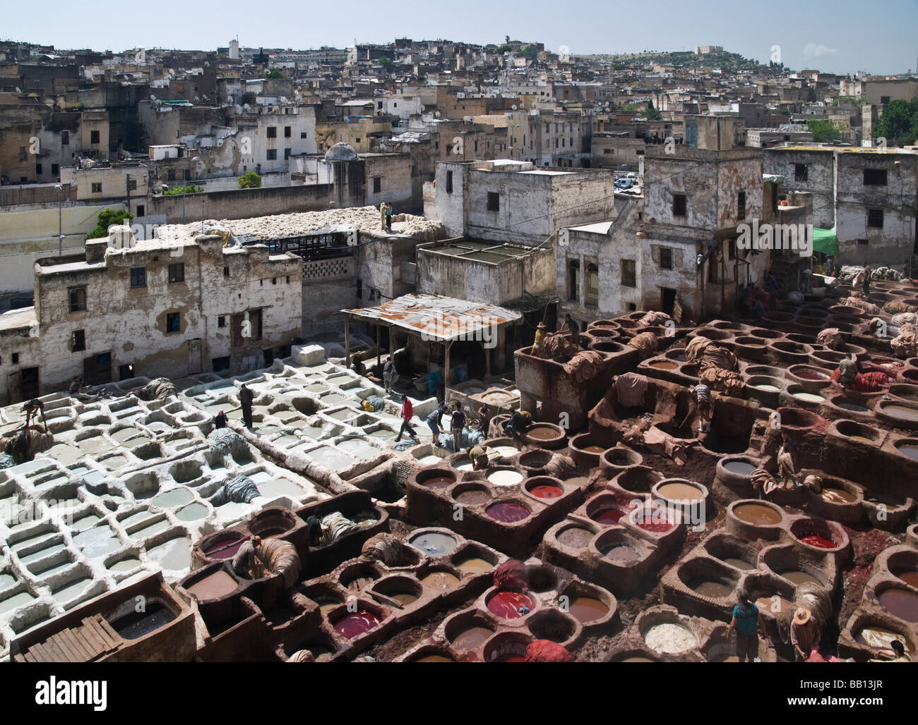 Chouara tannery in medina. Yellow from saffron, red from poppies, blue from indigo, green from mint, orange from - Stock Image