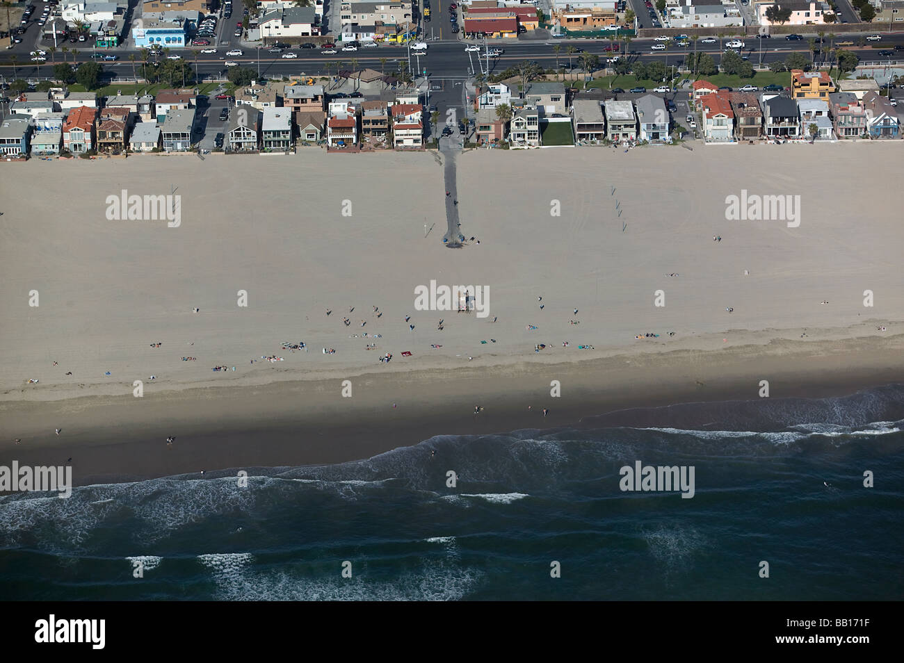 aerial view above southern California Pacific ocean beach front houses public access sunbathers near Newport Beach - Stock Image