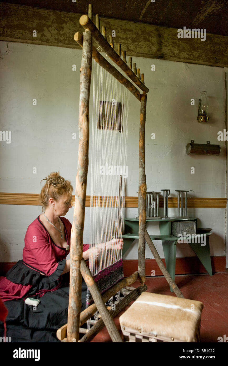 Woman weaving with Iroquois style loom at Nellis Tavern historic site textile fair New York state Mohawk Valley - Stock Image