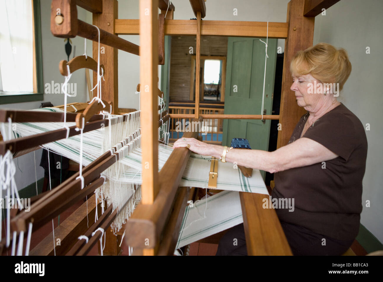 Woman weaving at Nellis Tavern historic site textile and fabric show St Johnsville New York state Montgomery County - Stock Image