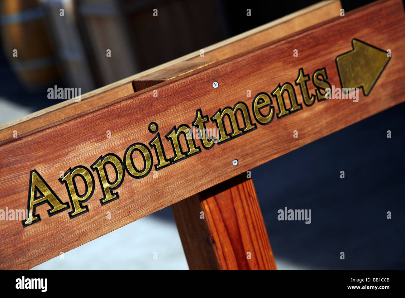 appointments sign with arrow - Stock Image