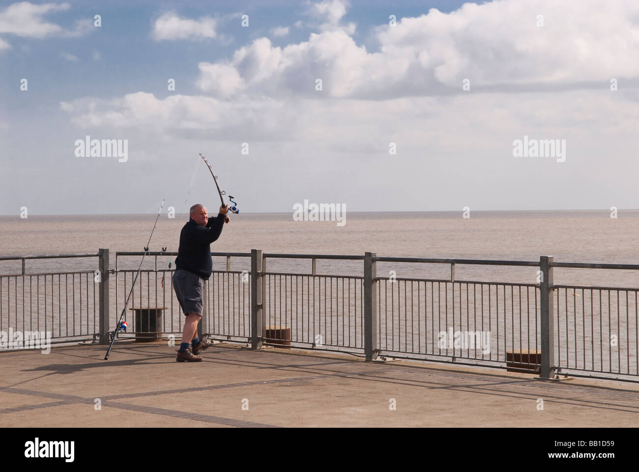 Man fishing off pier stock photos man fishing off pier for Fishing off a pier