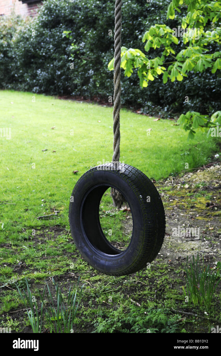 Rope Swing Old Tyre Hanging From A Rope In A Tree At Rest Just Stock Photo Alamy