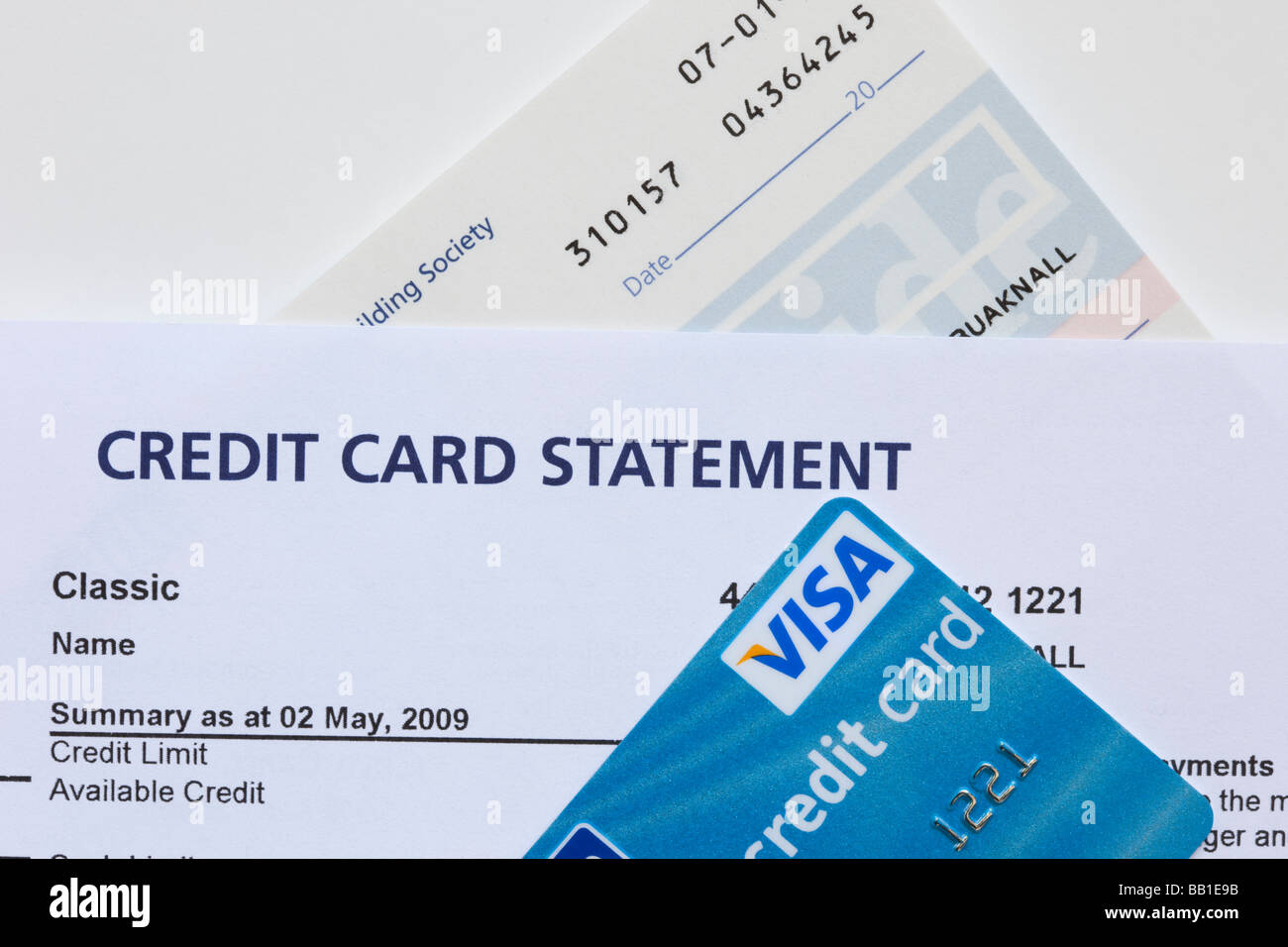 Credit card statement with Visa card and cheque book close up