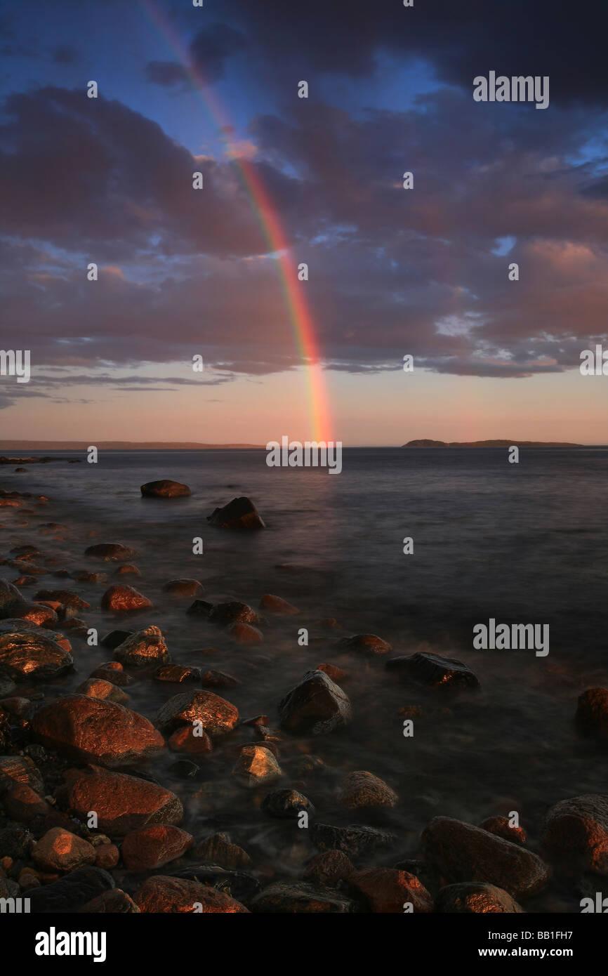 Amazing rainbow over the Oslofjord at Larkollen, Østfold fylke, Norway. - Stock Image