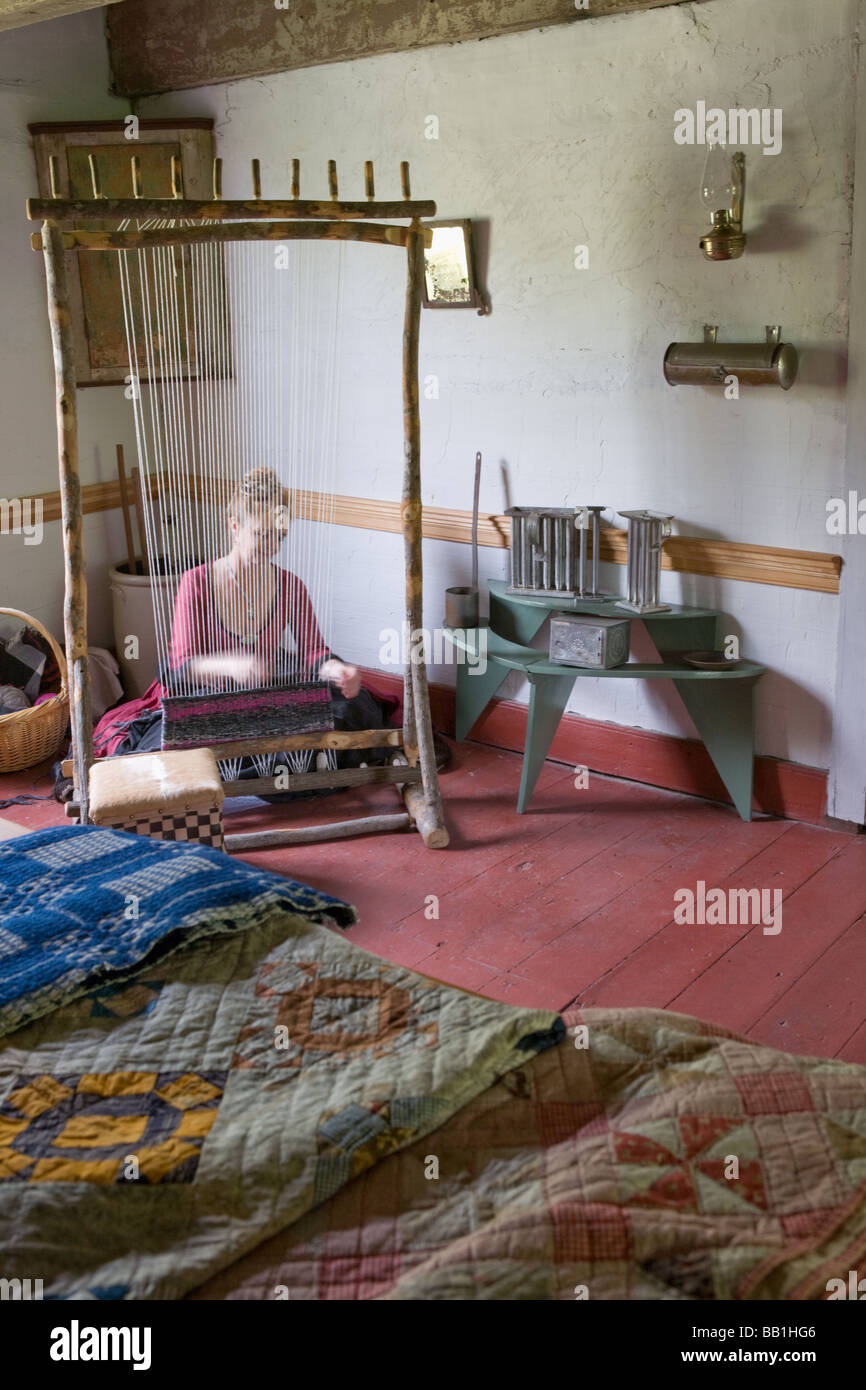 Woman weaving with Iroquois style loom at Nellis Tavern historic site textile fair New York state Mohawk Valley Stock Photo