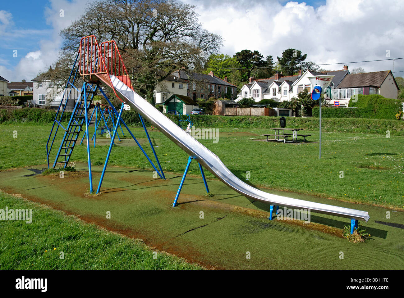 an empty childrens slide in a playground in cornwall,uk Stock Photo