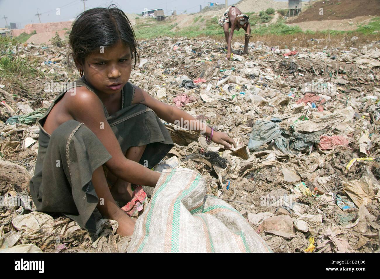 Children scavenging in garbage dump, Dhaka, Bangladesh Stock Photo - Alamy