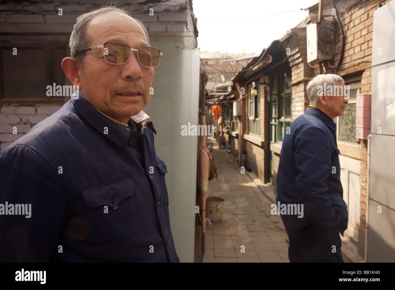 Old men in communist uniform in Hutong Beijing China - Stock Image