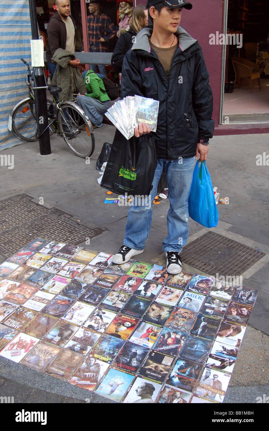 Illegal DVD copies market salesman chinese Stock Photo