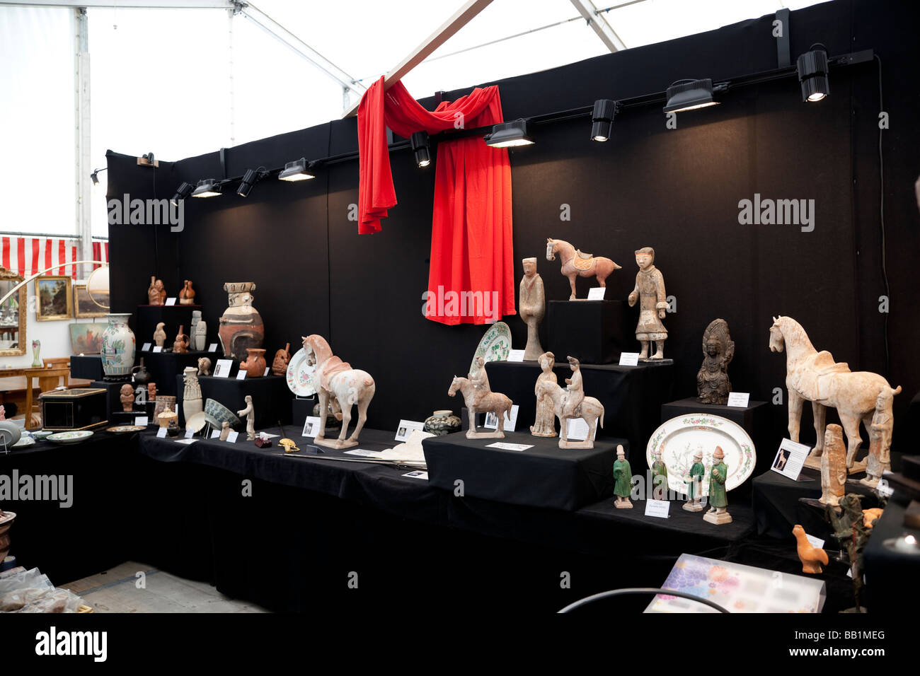 Booth specializing in Chinese and oriental antiques at the antique market Neuchatel Switzerland - Stock Image