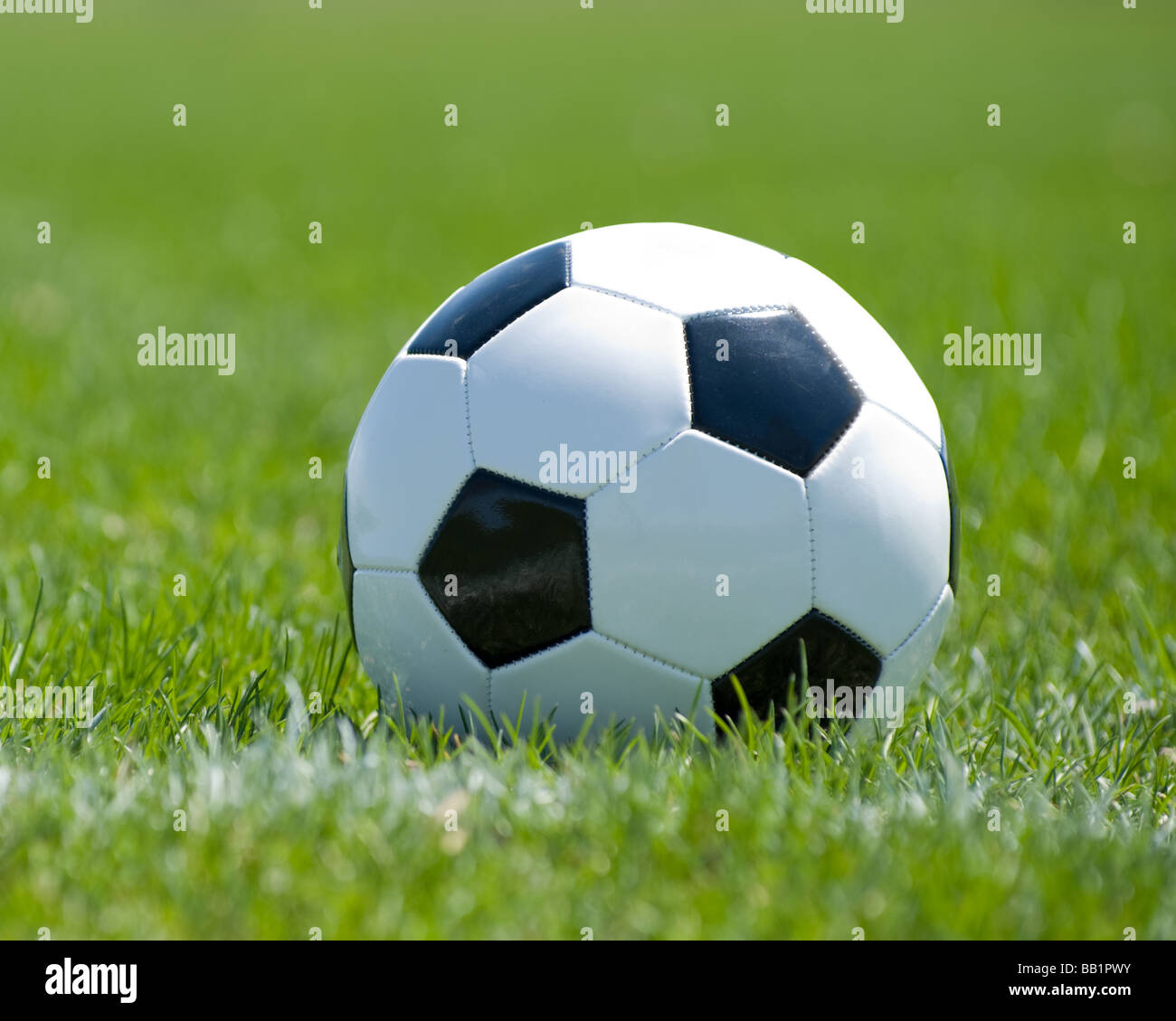 Soccer ball in the corner pitch area - Stock Image