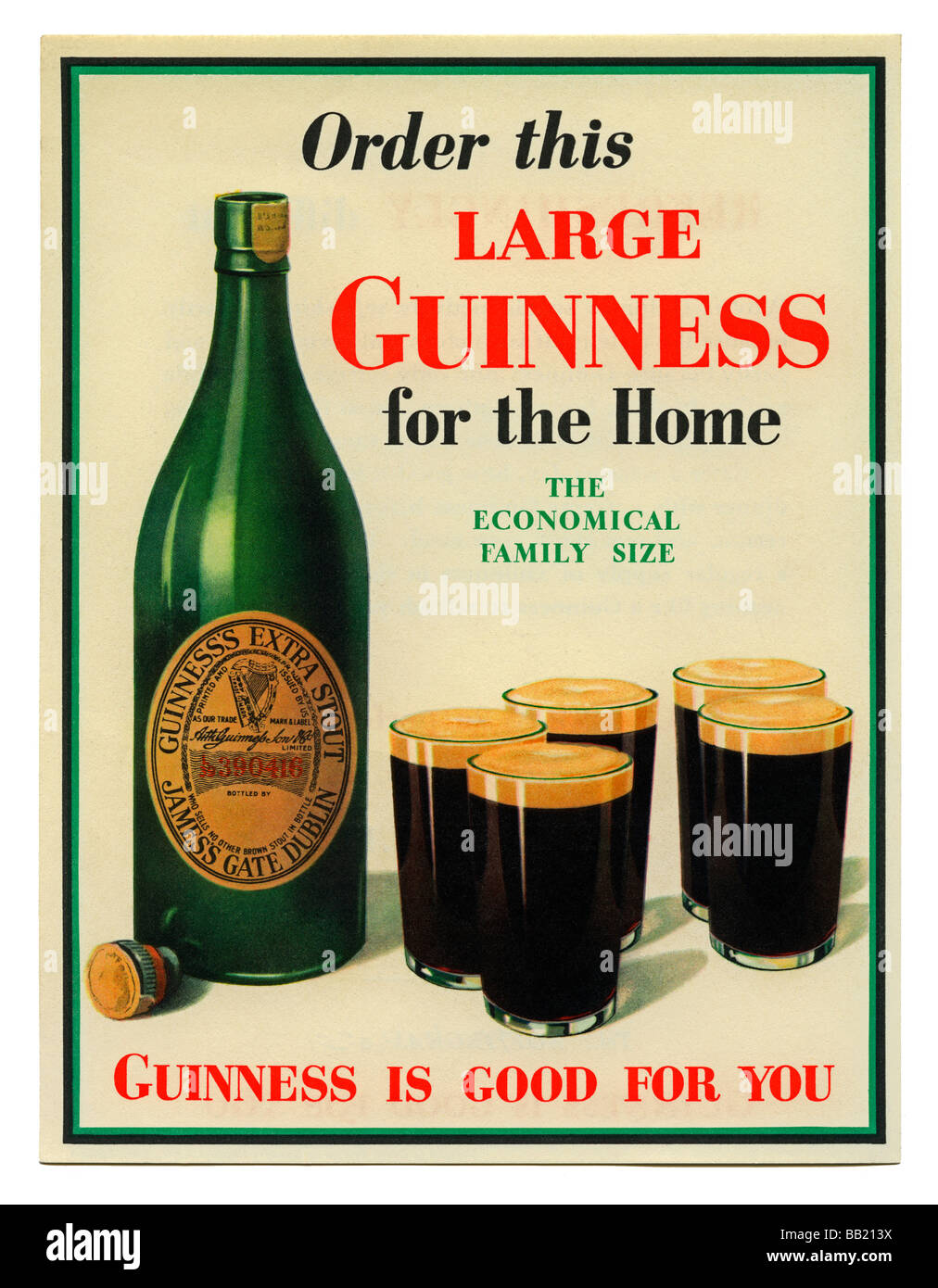 An old small poster advertising a large bottle of Guinness Extra Stout to drink at home, c. 1950 - Stock Image