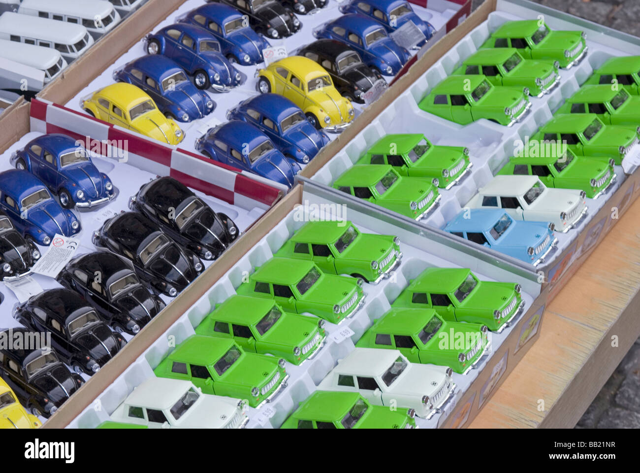 Toy Trabant and Volkswagen cars for sale on a tourist souvenir stall in Berlin Germany - Stock Image