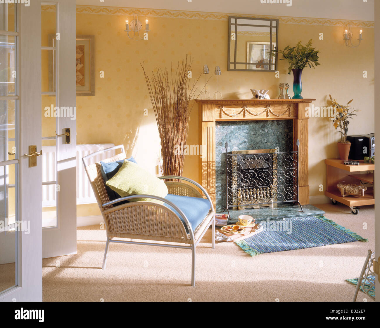 a classically designed english home and fireplace - Stock Image