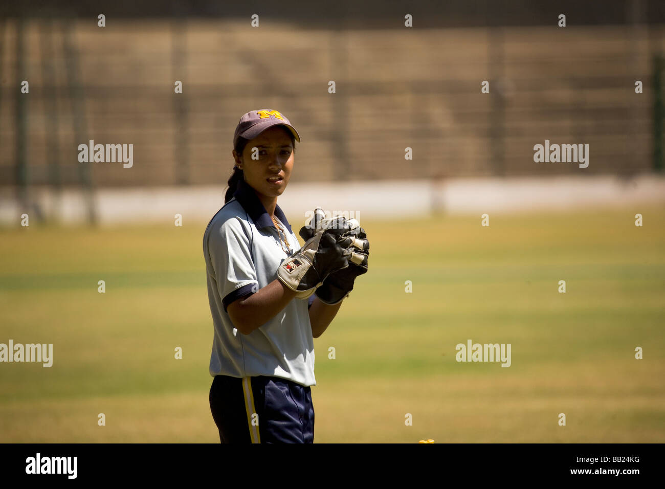 A wicketkeeper and member of India women's cricket squad in training at the M. Chinnaswamy stadium in Bangalore, - Stock Image