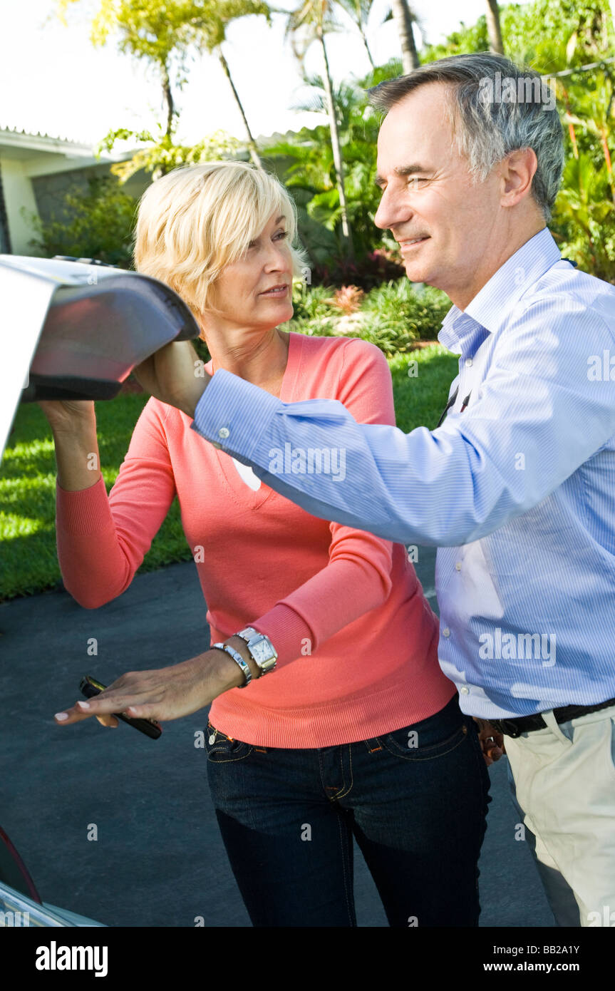 Couple holding a car trunk - Stock Image