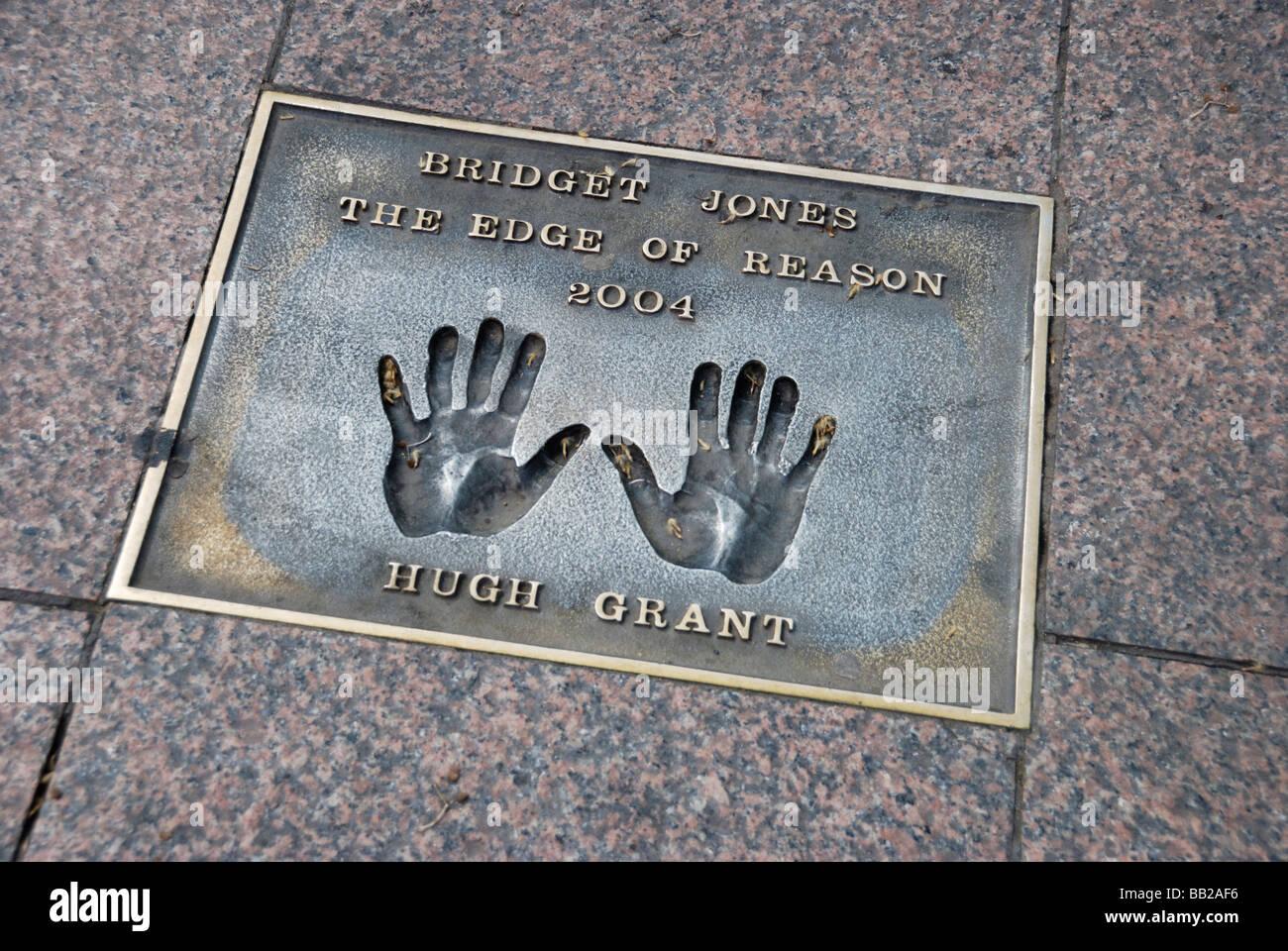 Hugh Grant handprints in pavement commemorating the film Bridget Jones the Edge of Reason Leicester Square London - Stock Image