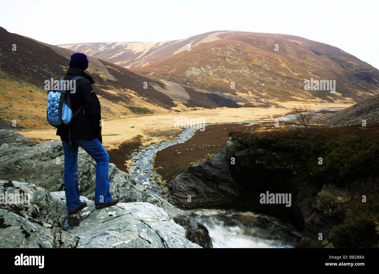 A hillwalker at the top of the Falls of Unich at Glen Esk, Angus, Scotland, UK. - Stock Image