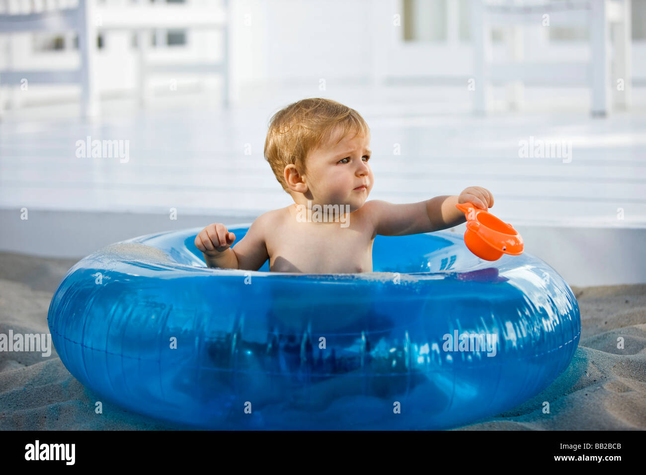 Baby boy sitting in an inflatable ring Stock Photo: 24024459 - Alamy