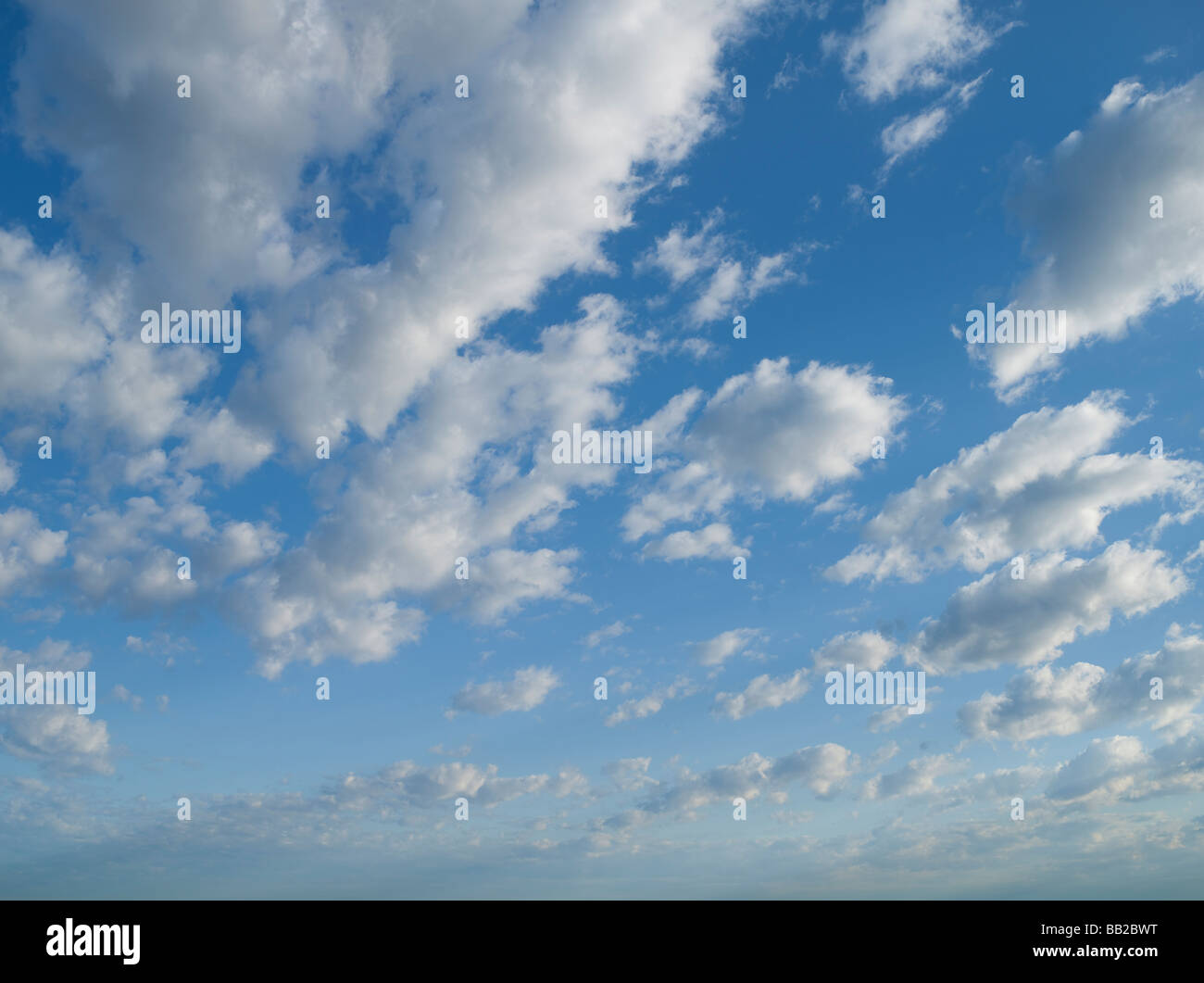 Blue Sky with puffy clouds - Stock Image