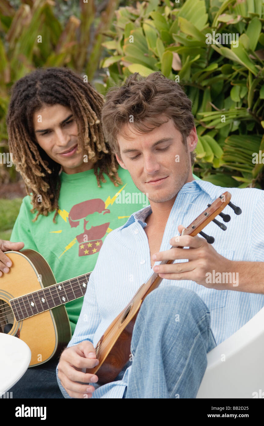 Two men playing guitars - Stock Image