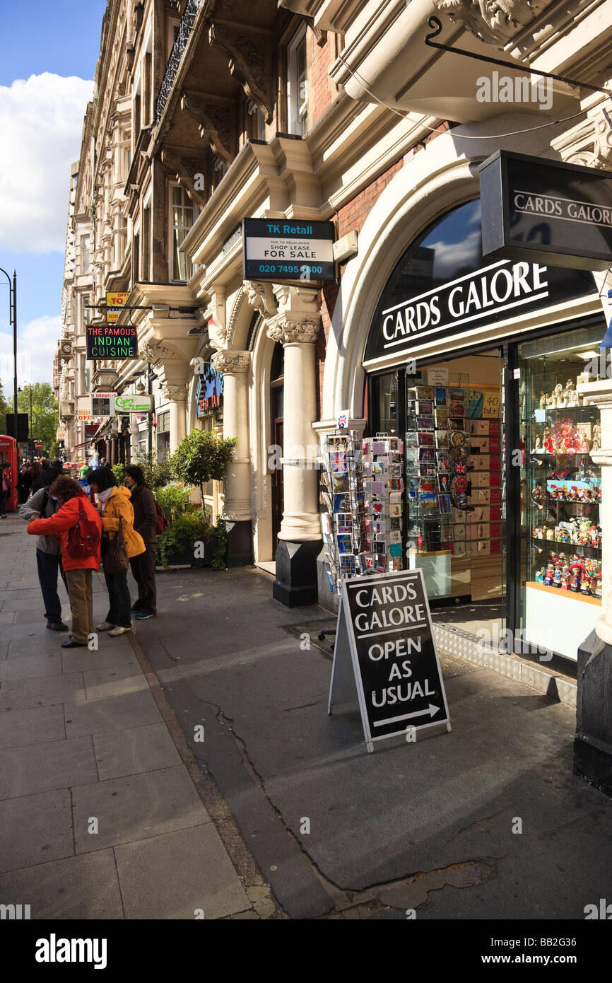 The Map Shop London.Tourists Looking At A Map Outside A Postcard And Gift Shop On Stock