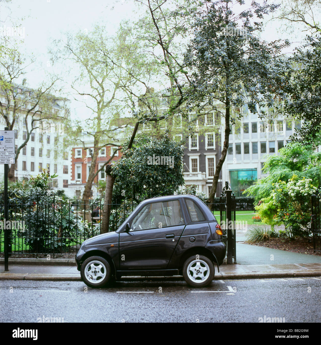 A fuel efficient G WIZ car parked in the street near Hanover Square in  London England UK   KATHY DEWITT - Stock Image