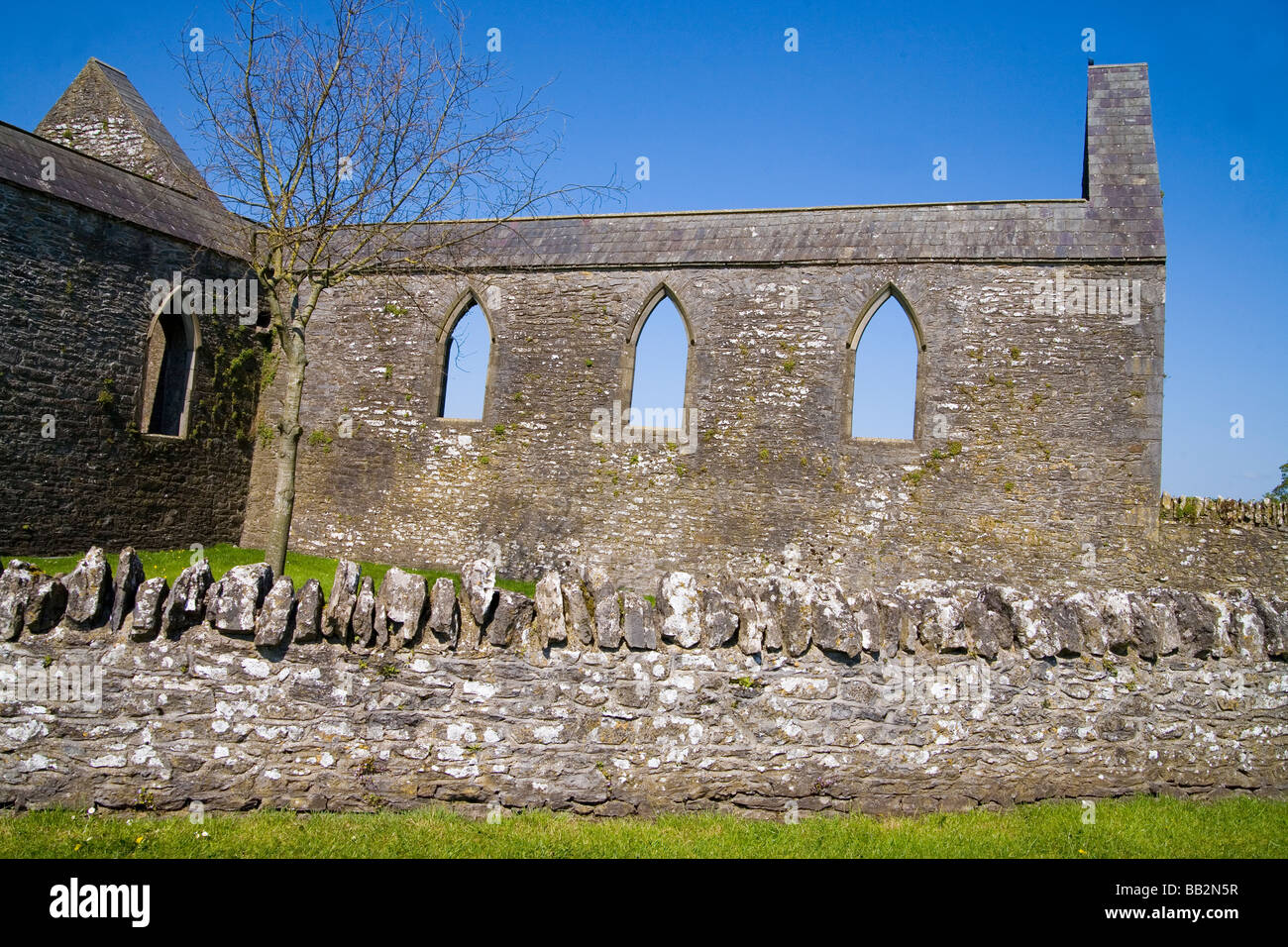 Old stone church wall and in Western Ireland - Stock Image