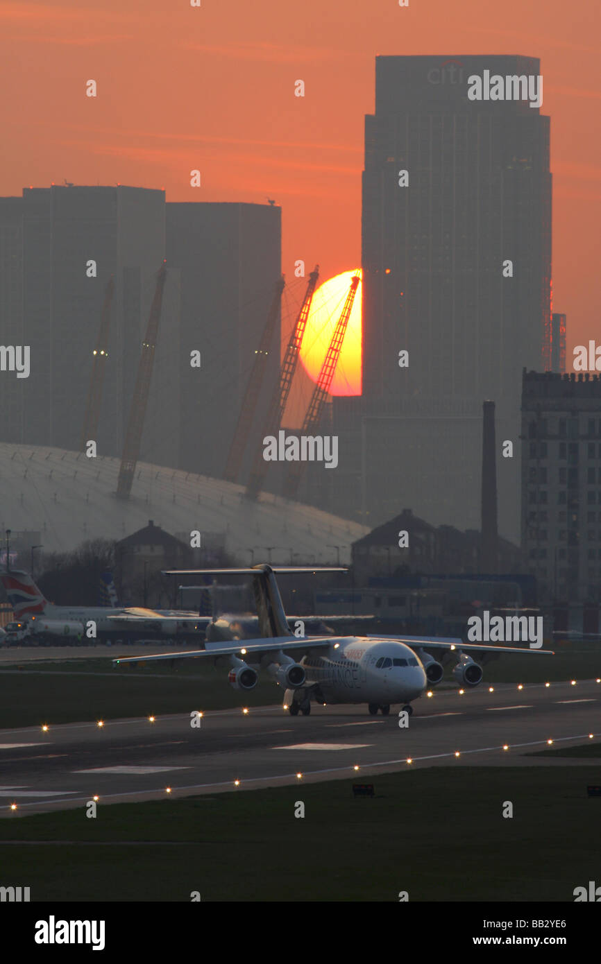 Evening London City airport overview with City skyscraper's in the background. - Stock Image