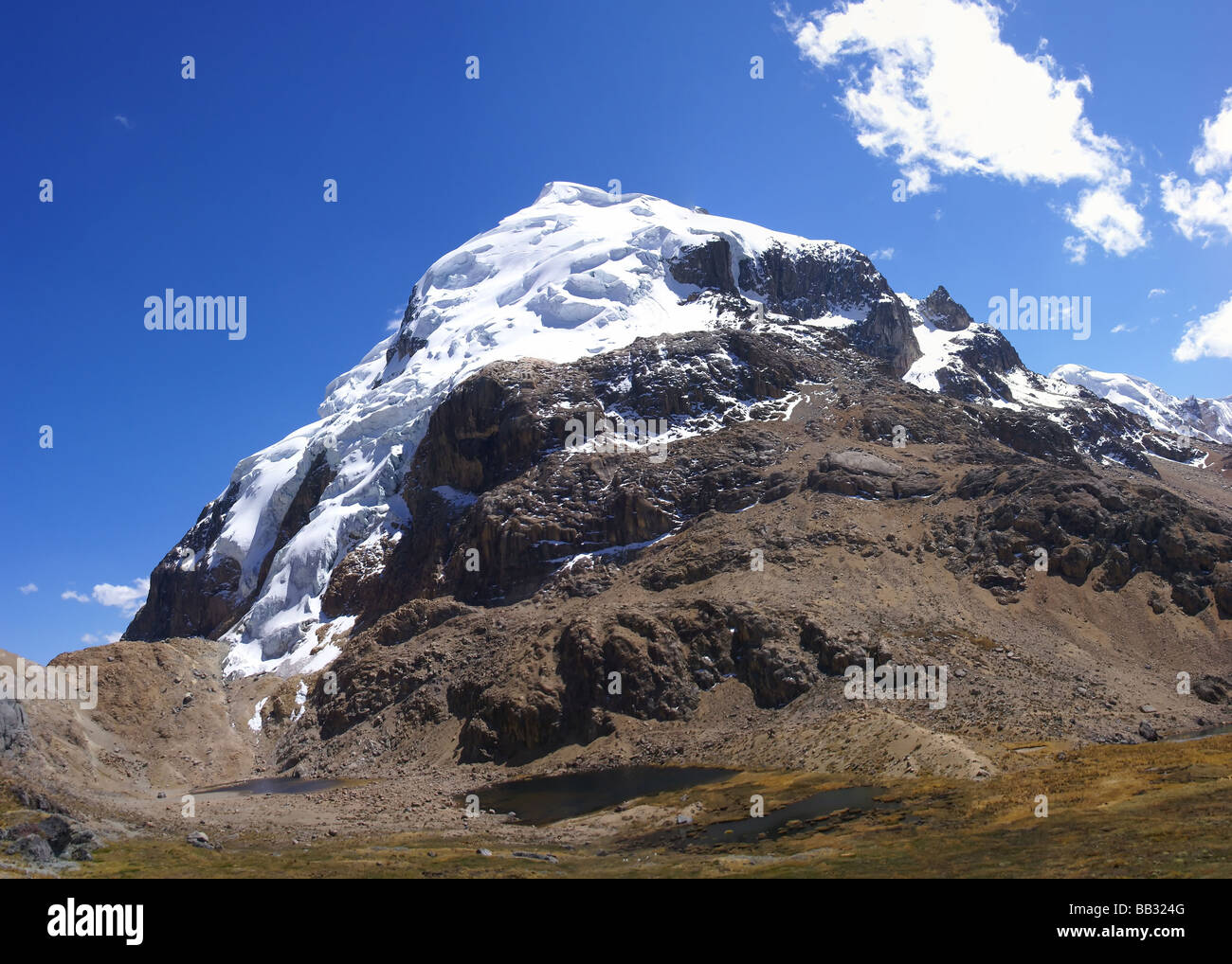 Hanging glaciers on steep rocky mountain Cuyoc Cordillera Huayhuash Andes Peru South America - Stock Image