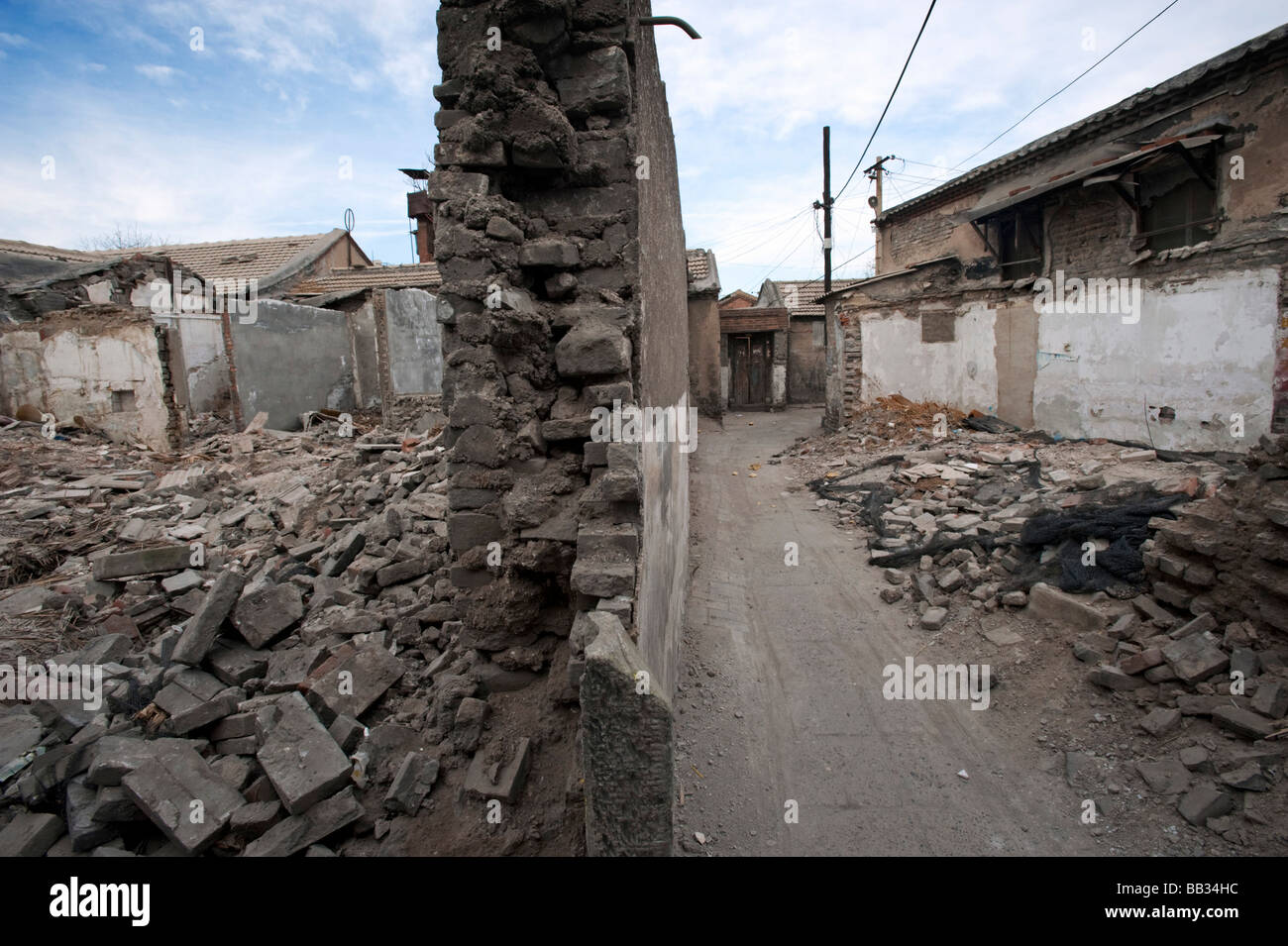 Demolition in progress of historic houses in an area of traditional hutong streets for redevelopment in Beijing - Stock Image