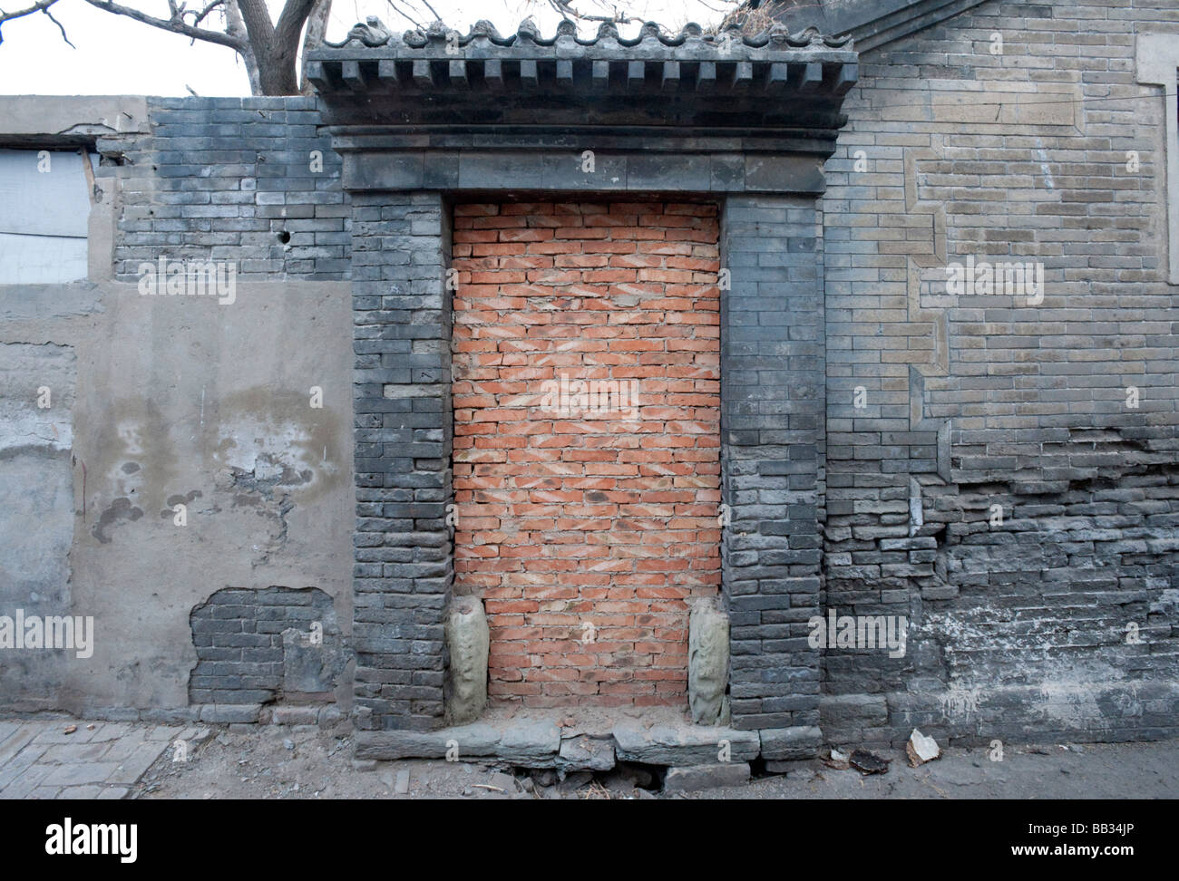 Historic traditional doorway to house in Beijing hutong bricked up prior to demolition in area undergoing redevelopment - Stock Image