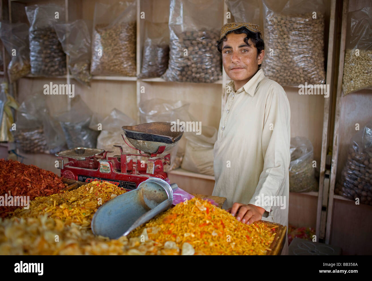 Child selling spices at the Itwar Bazar in Islamabad Pakistan - Stock Image
