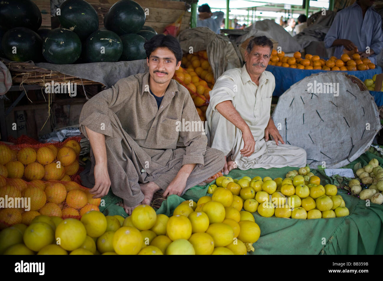 Men selling fruits at the Itwar Bazar in Islamabad Pakistan - Stock Image