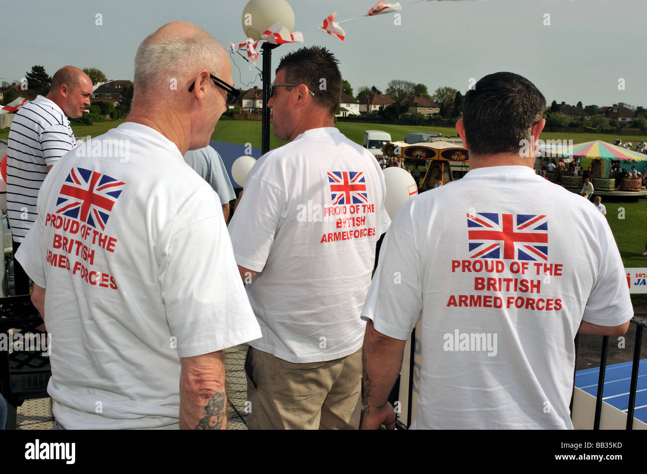 Three men wearing Tee Shirts with the slogan Proud Of The British Forces at a fundraising event Ewell Surrey UK - Stock Image