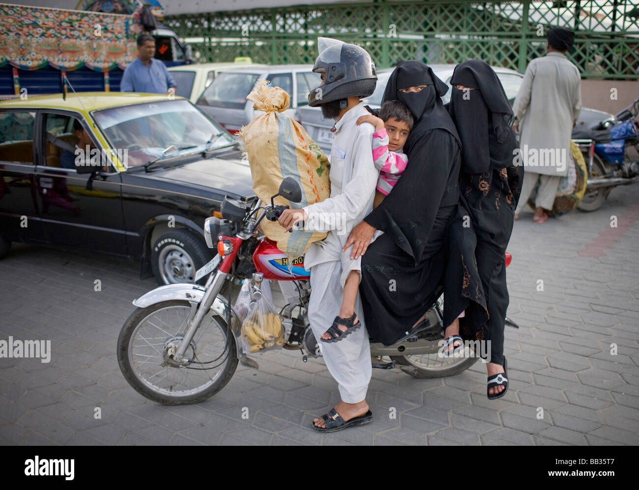 Family on a motorbike Islamabad Pakistan - Stock Image
