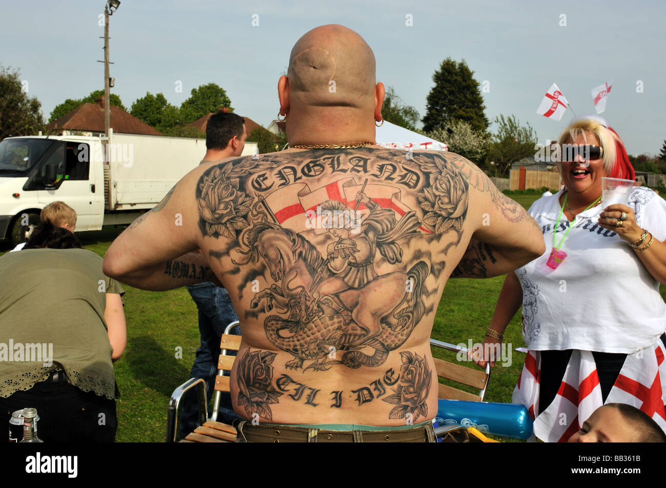 a man displaying his england tattoo which covers his back and shows stock photo 24042183 alamy. Black Bedroom Furniture Sets. Home Design Ideas