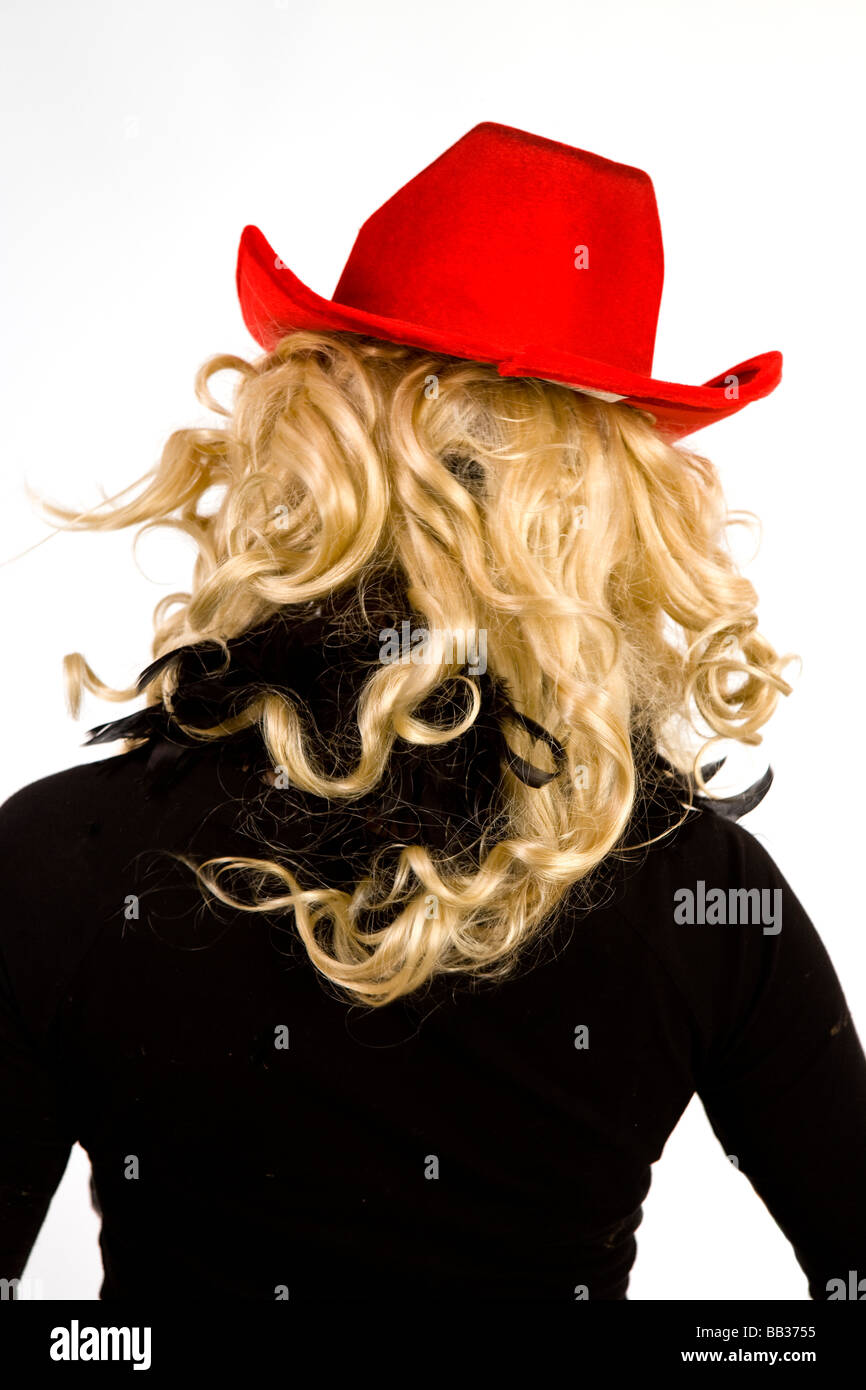 edd4b0b7d11 a blonde woman with a red cowboy hat poses for a photograph at glastonbury  festival