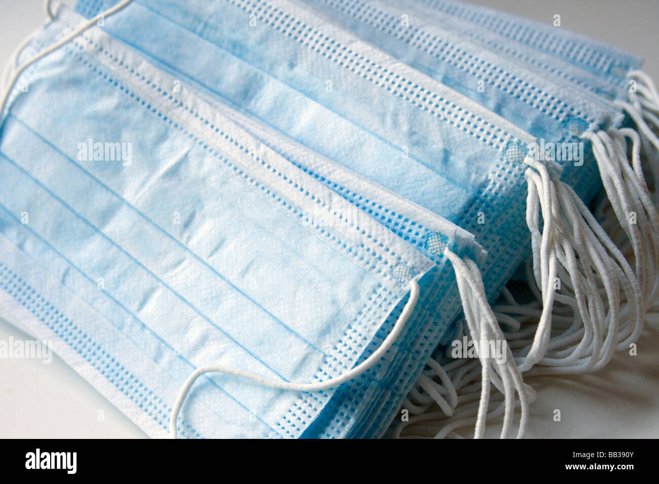 Bunch of blue surgical protection masks. - Stock Image