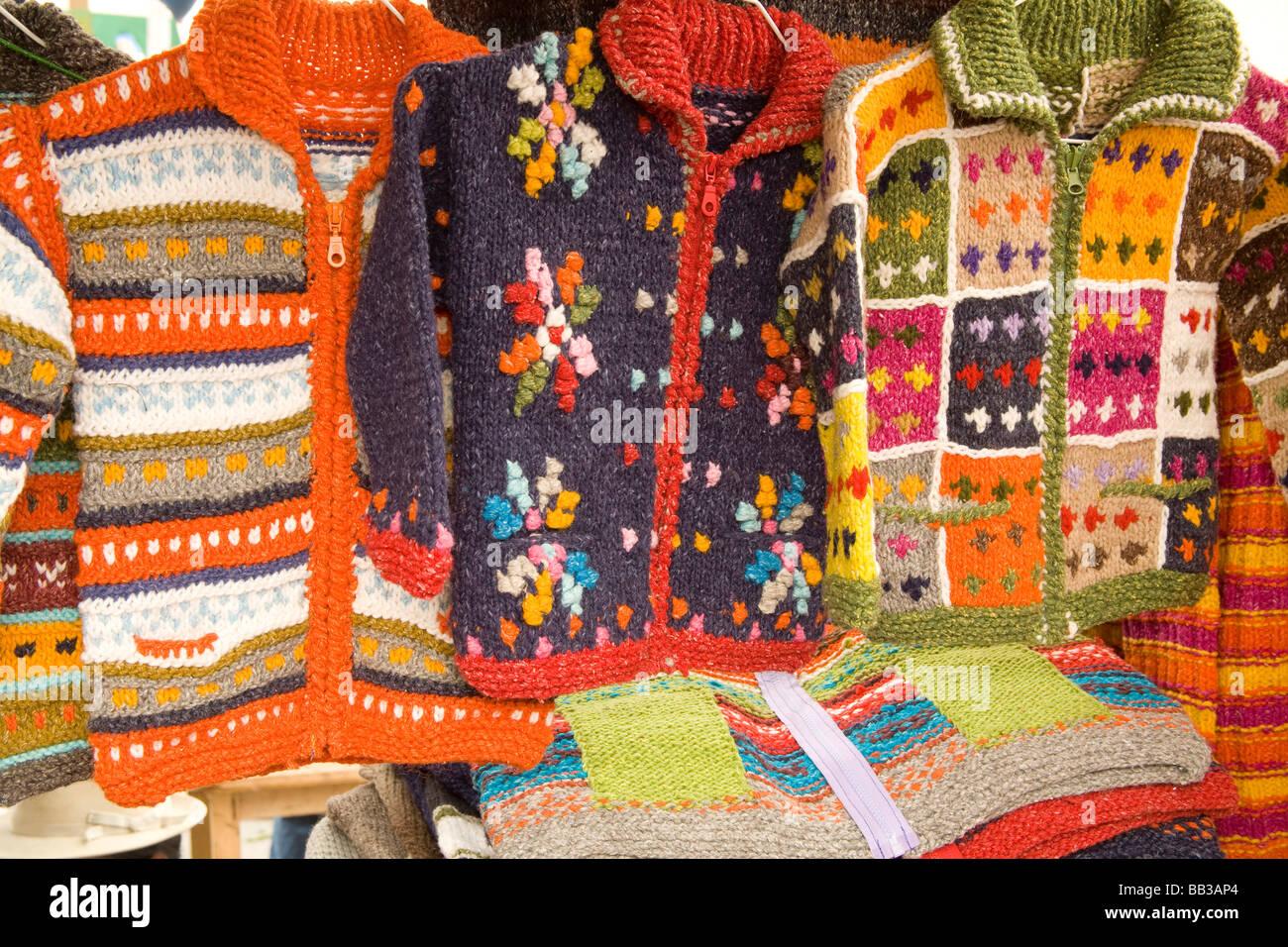 South America, Ecuador, Otavalo,  Plaza de Ponchos, sweaters on display at the Saturday textile & crafts market - Stock Image