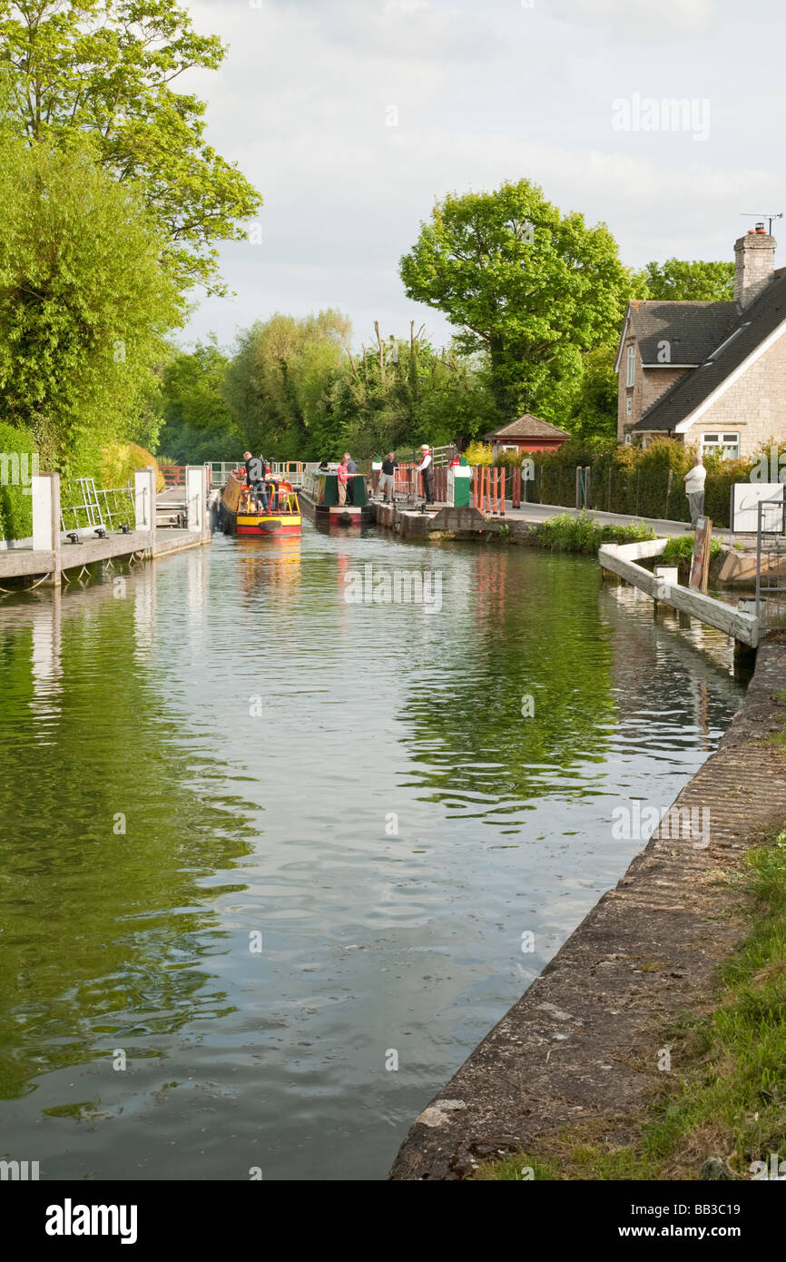 Narrowboats negotiating Osney Lock on the River Thames in Oxford Uk - Stock Image
