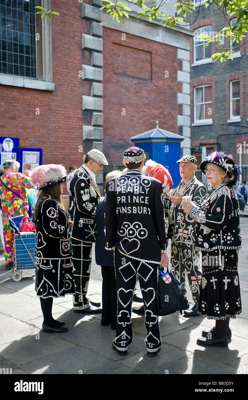 Pearly Kings and Queens talking in the grounds of St Pauls Church in Covent Garden in London.  Photo by Gordon Scammell - Stock Image