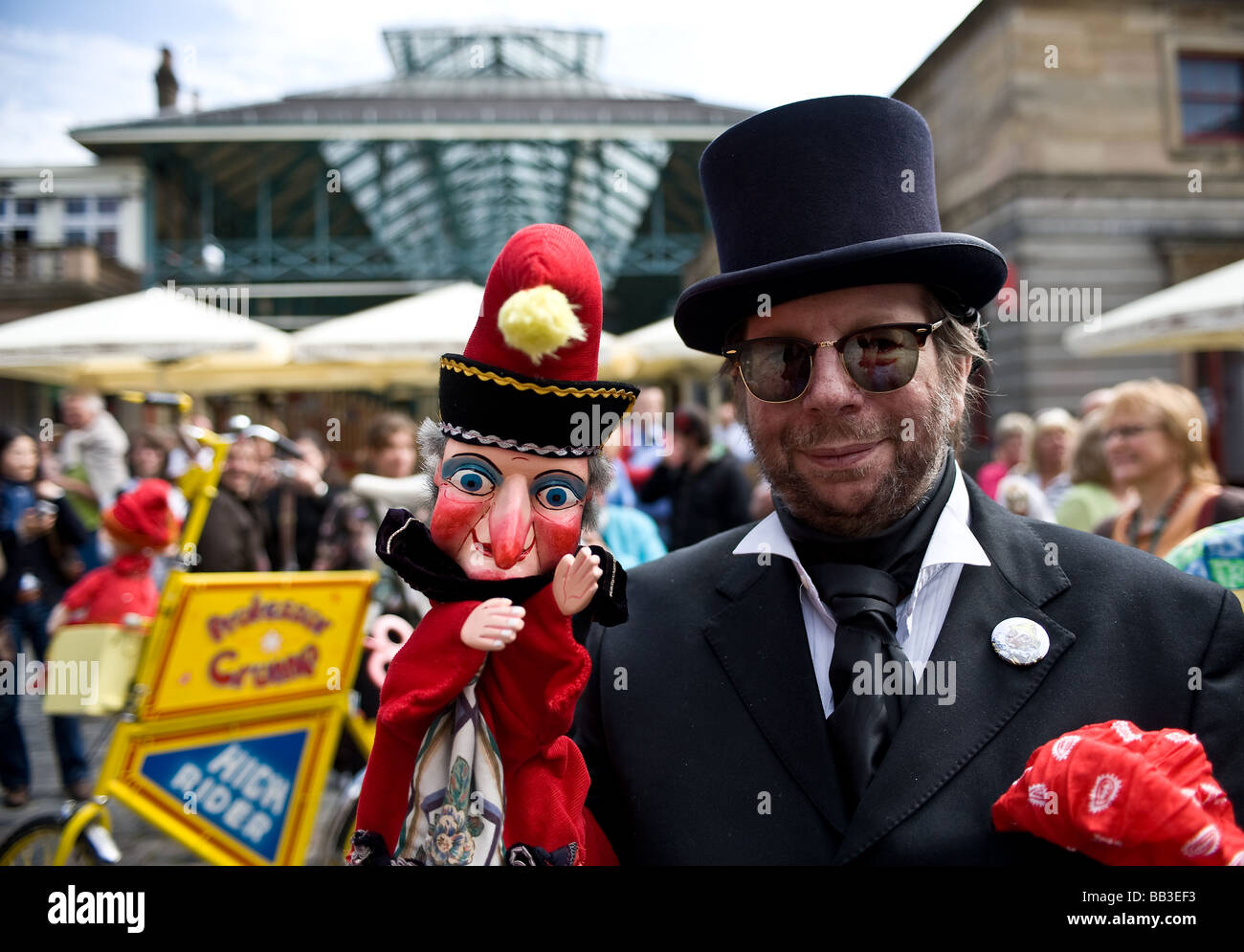 A professor and Mr Punch in the piazza at Covent Garden in London. - Stock Image