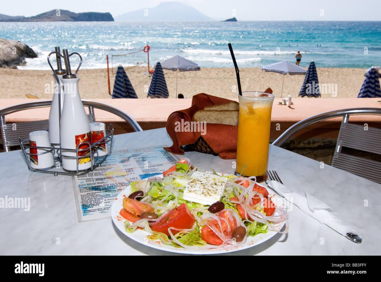 Greek Island Karpathos: Greek salad at the beach. Stock Photo