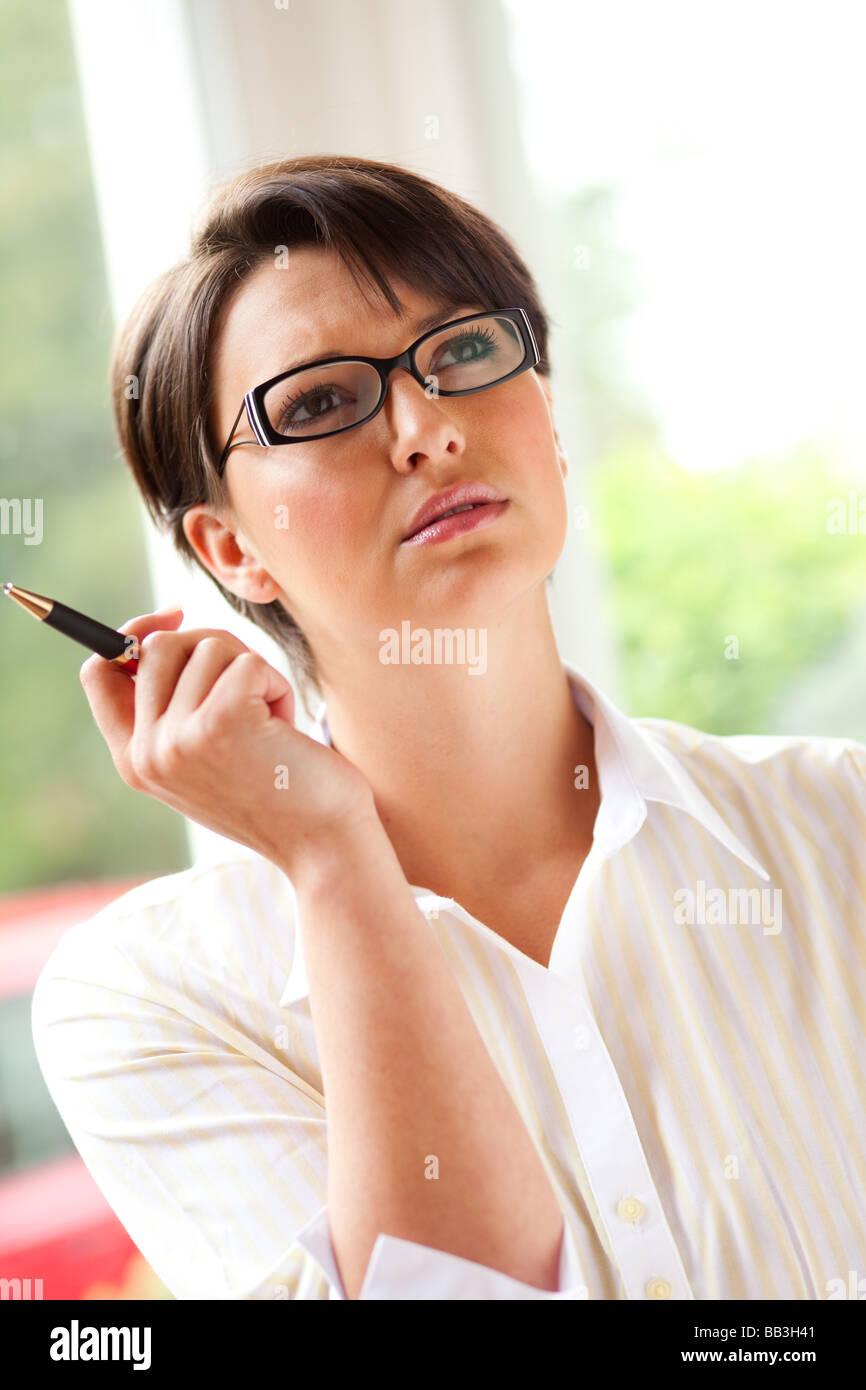 Woman thinking - Stock Image