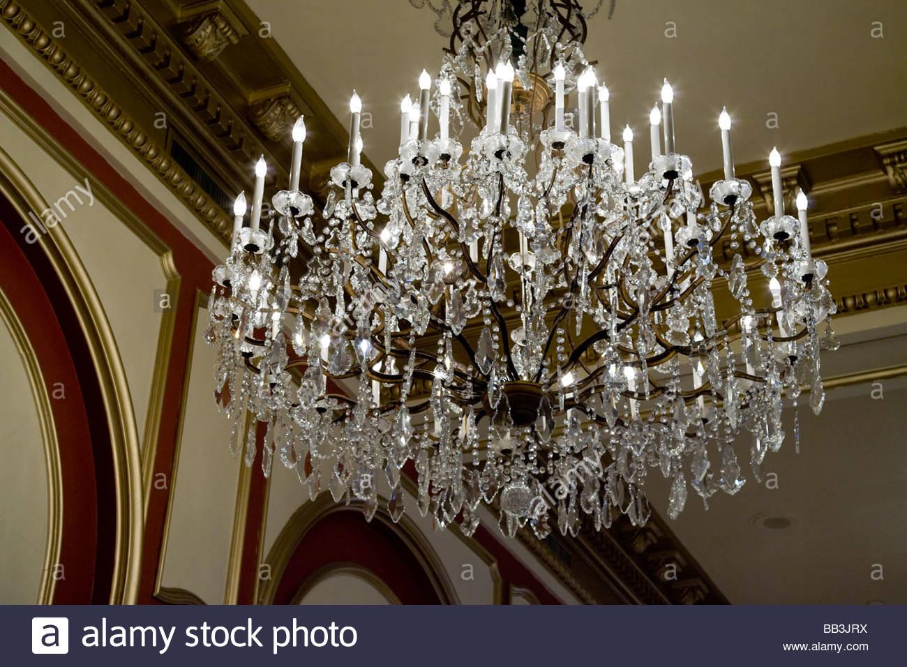 Ornate chandelier stock photos ornate chandelier stock images alamy an ornate chandelier in the lobby of le pavillon aloadofball Gallery