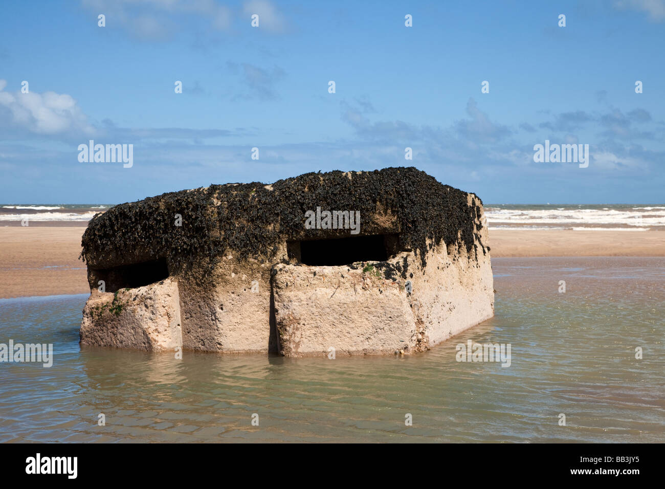 WW2 pillbox ruin on the beach near Easington, East Yorkshire, England, UK - Stock Image