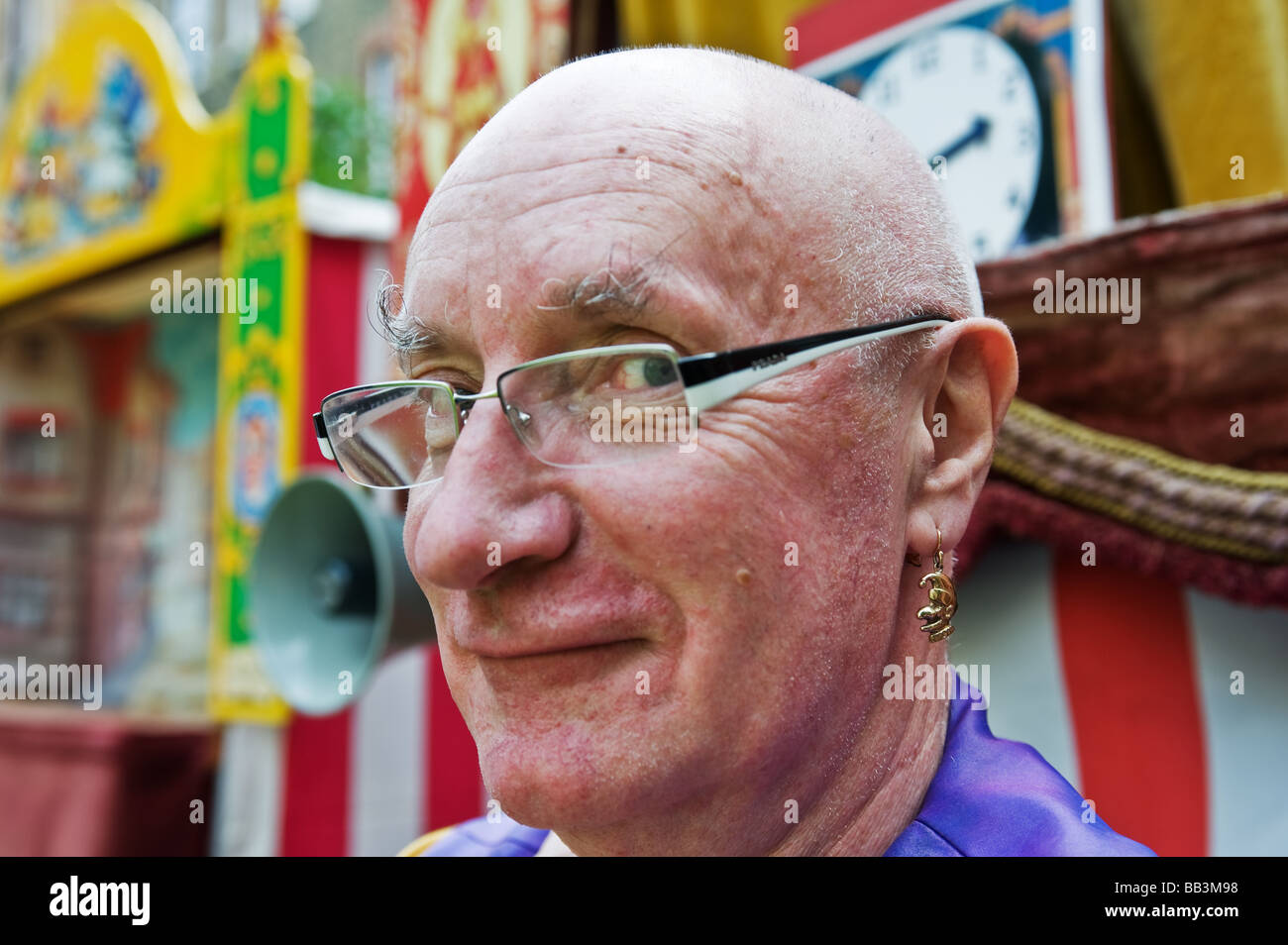 Professor Glyn Edwards wearing a Punch and Judy earring.  Photo by Gordon Scammell - Stock Image