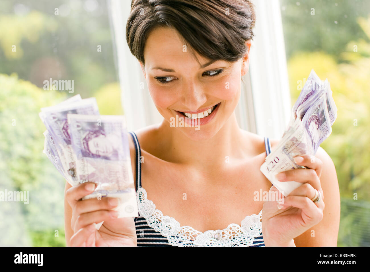 Girl with Cash - Stock Image